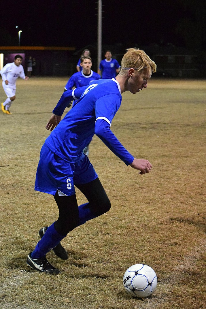 Kingman's Tristan Hanks pushes the ball for the Bulldogs during Kingman's 2-1 overtime loss at Lake Havasu Thursday.