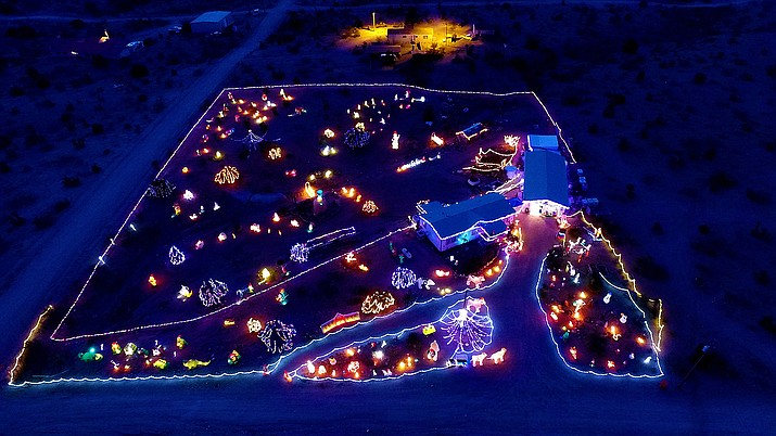 The Meriwether home at 2225 S. Dome Road features about 100 blowups and 75,000 lights.