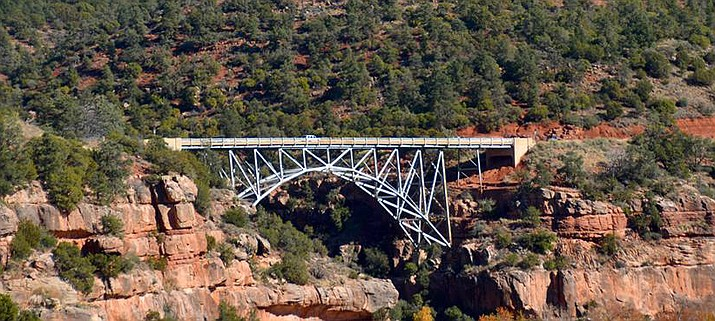 The city of Sedona sought ADOT's help after four people committed suicide from the bridge in 2015. After working with a nonprofit organization to add signs carrying the number of a suicide-prevention hotline, ADOT worked with area partners to design fencing for the bridge, located a mile and a half north of Sedona. (VVN/Vyto Starinskas)