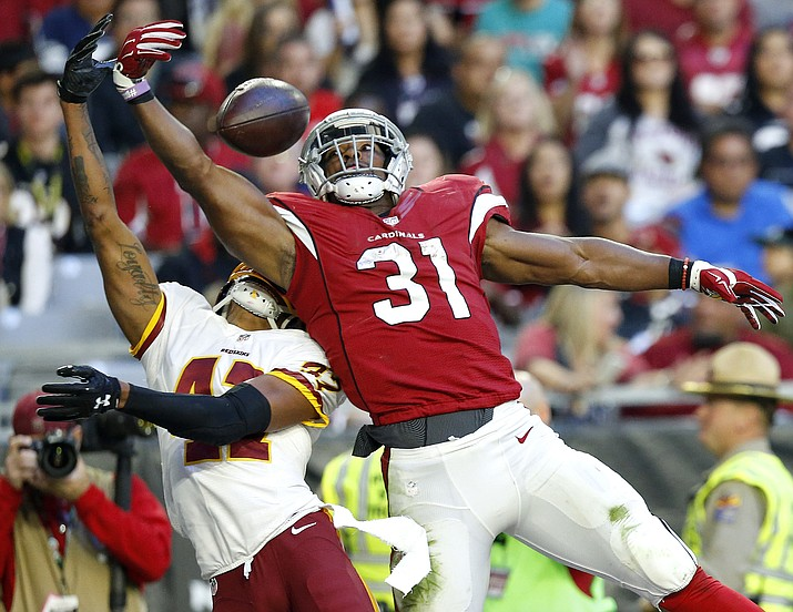 Arizona Cardinals running back David Johnson (31) can't make the catch as Washington Redskins free safety Will Blackmon (41) defends during the second half of an NFL football game, Sunday, Dec. 4, in Glendale.
