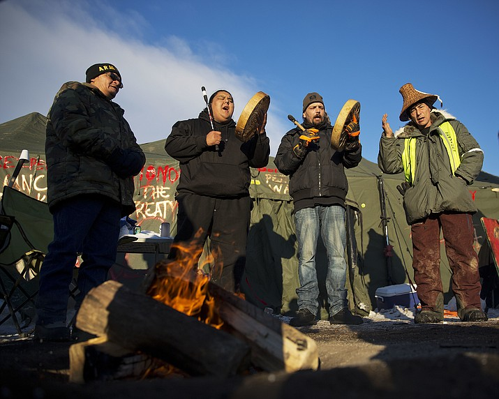 From left: Eugene Sanchez, Jason Umtuch, Martan Mendenhall, and Hugh Ahnatock, all of Portland, Ore., drum and sing at the Oceti Sakowin camp where people have gathered to protest the Dakota Access oil pipeline (DAPL) in Cannon Ball, N.D. Dec. 4. The U.S. Army Corps of Engineers said Sunday it won't grant an easement for the DAPL in southern North Dakota, handing a victory to the Standing Rock Sioux tribe and its supporters, who argued the project would threaten the tribe's water source and cultural sites. AP Photo/David Goldman
