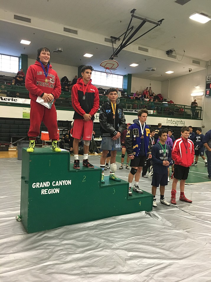 Nic Verville stands tall on top of the podium at the Wade Hendershott Peaks Invitational after winning the 132-pound tournament championship.