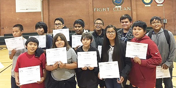 Students with perfect attendance for the fall semester at Tuba City Jr. High proudly display their certificates during a school assembly. Rosanda Suetopka/NHO