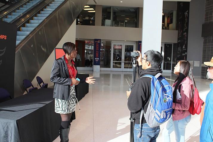 Hopi High School media student Breana Saufkie interviews Phoenix Suns account executive Brianna Eason. Kyle Secakuku shoots the video interview. Stan Bindell/NHO