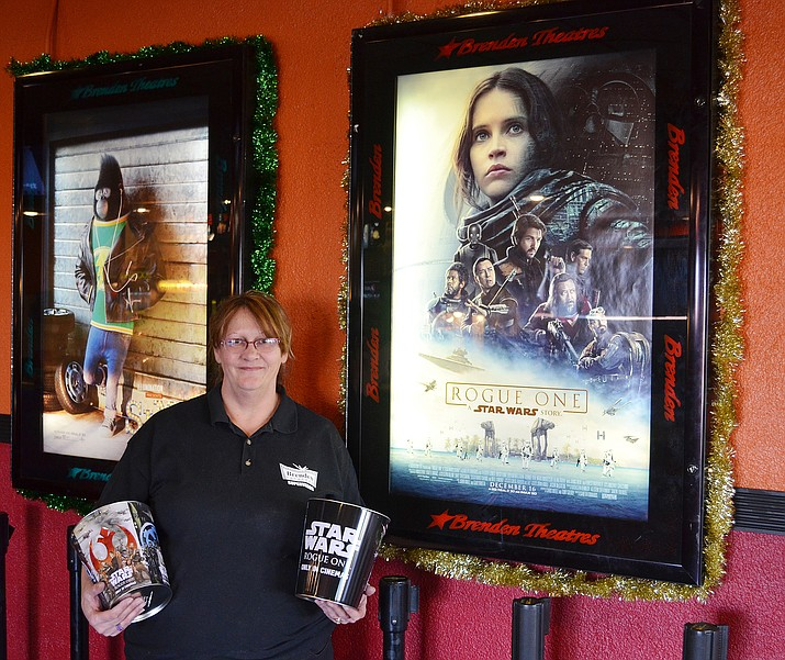 Annette Lochner, general manager of Brenden Theatre's Kingman Cinema stands with some 'Rouge One: A Star Wars Story' promotional items.
