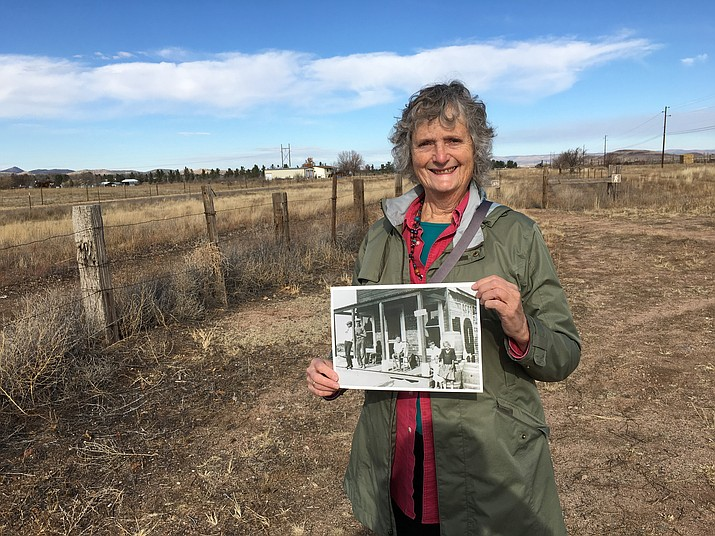 Kay Lauster, president of the Chino Valley HIstorical Society, holds a circa 1920s photo of the Longmore Store at Jerome Junction on Friday, Dec. 2. The building, now located at Road 1 North and Highway 89, is in the way of a future traffic light and road improvements. Lauster hopes to save the building and turn it into a Jerome Junction museum.