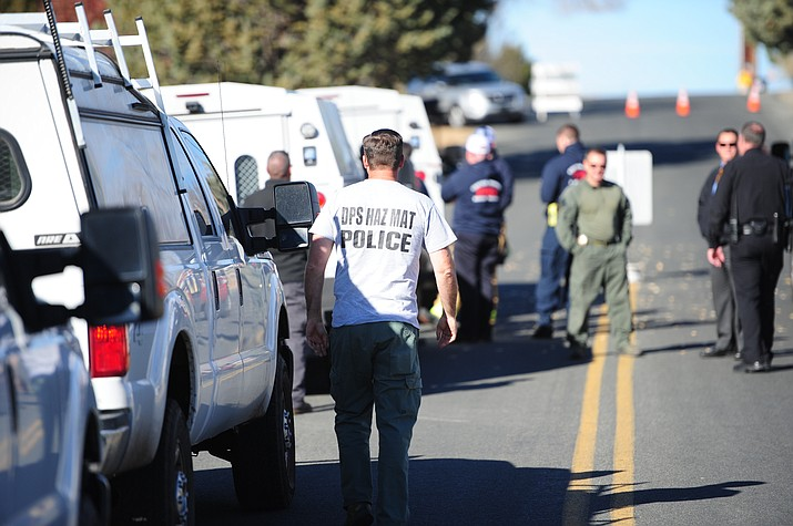 Emergency personnel, including Prescott Valley Police, Central Arizona Fire, Lifeline Ambulance and Department of Public Safety Hazardous Material Response Unit, in the 6500 block of Cattletrack Road in Prescott Valley for a hazardous material call Thursday, December 8. (Les Stukenberg/The Daily Courier)