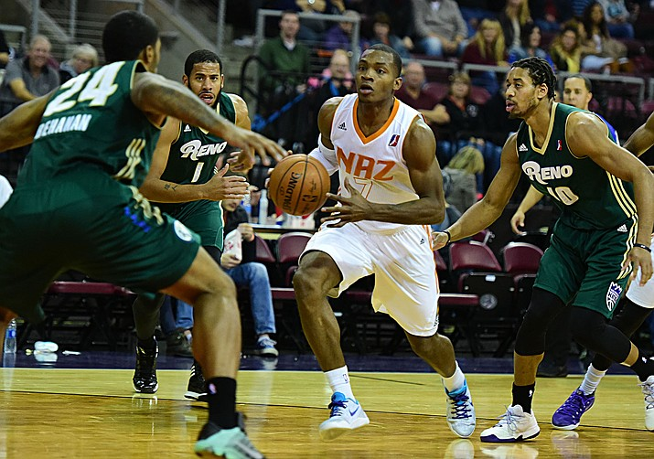 Northern Arizona's Elijah Millsap moves through three defenders as the Suns take on the Reno Bighorns on Nov. 25. Millsap scored 22 points against the Bighorns in Reno on Saturday, Jan. 7, but the Suns lost in overtime, 91-89. (Les Stukenberg/The Daily Courier)