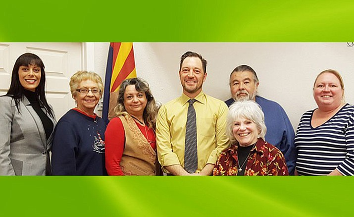 From left, Tosca Henry, Linda Norman, Kyla Allen, Mayor Tim Elinski, Vice Mayor Karen Pfeifer, Ruben Jauregui and Deb Althouse pose for a picture after Tuesday night's City Council Meeting in Cottonwood. (VVN/Jennifer Kucich)