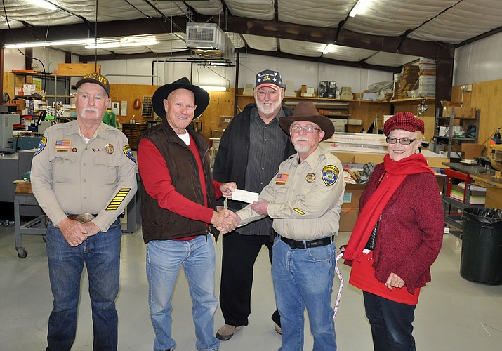 From the left is SAR Kingman Unit Vice President Tom Blum, ATV Club President Jim Johnson, who is presenting the check to SAR Kingman Unit Commander Buffalo Hayden; ATV Club Vice President Terry Jones, and ATV Club Secretary Wendy Dunlap. The club generated the donation through fundraising.