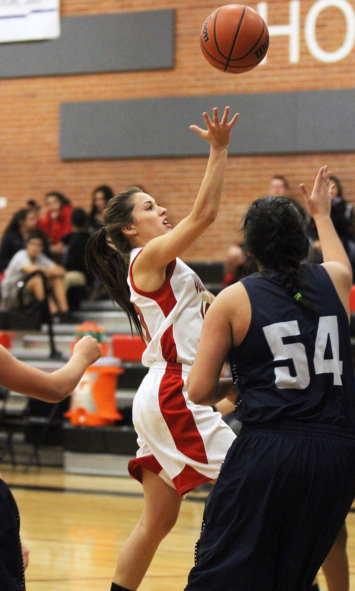 Madi Arave scores on a layup for two of her eight points in Lee Williams' 35-29 win over Tempe Friday at LWHS.