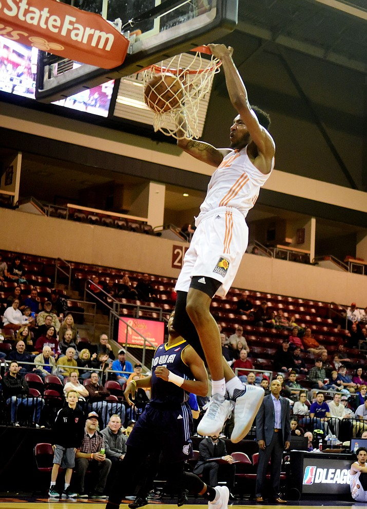 Northern Arizona's Derrick Jones Jr. dunks the ball as the Suns take on the Iowa Energy Saturday, December 10 at the Prescott Valley Event Center.  (Les Stukenberg/The Daily Courier)