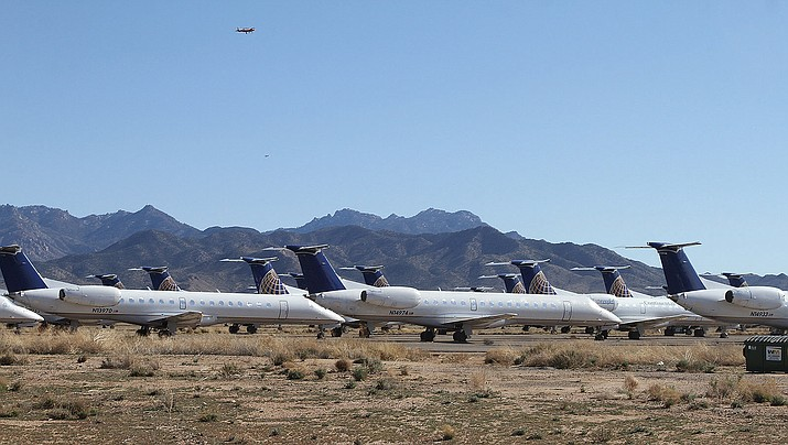 Commercial jets are stored at Kingman Airport, a sign the mid-market airline industry has yet to recover from the Great Recession. The tarmac is cracked and in a state of deterioration due to legacy contamination from a smelting operation in the 1940s. A Las Vegas-based investment group proposes to buy the airport and industrial park for $1 billion.