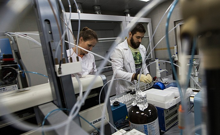 """Employees Natalya Bochkaryova, left, and Ilya Podolsky work May 24, 2016, at the Russia's national drug-testing laboratory in Moscow, Russia. It was at this laboratory, and its former site elsewhere in Moscow, that lab director Grigory Rodchenkov conducted pioneering research into steroids, at the same time as he says he was giving Russian athletes a """"cocktail"""" of banned substances."""