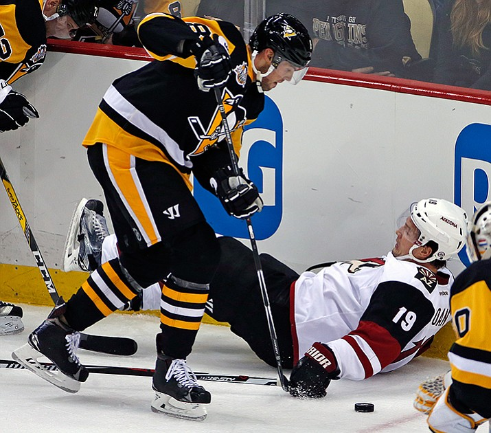 Pittsburgh Penguins' Brian Dumoulin (8) checks Arizona Coyotes' Shane Doan off the puck in the second period of an NHL hockey game in Pittsburgh, Monday, Dec. 12.