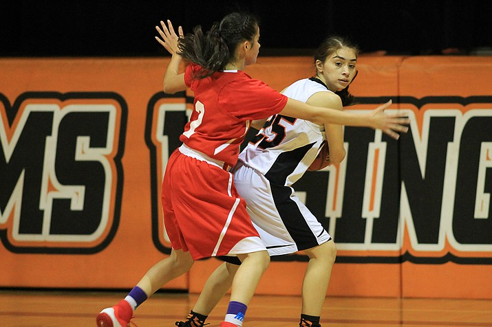 Diana Gonzalez works around a defender during the game with Grand Canyon.