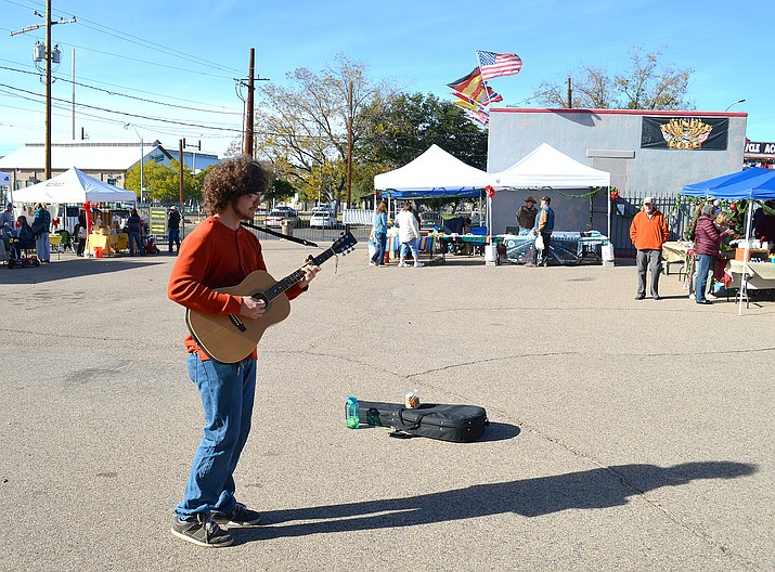 Local musician Jacob Metz provides a soundtrack for the Kingman Farmers Market Saturday morning.