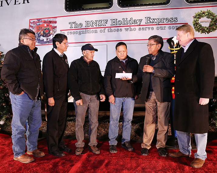 Navajo Nation President Russell Begaye and representatives of BNSF Railway present a check to Navajo Nation Veterans Administration Dec. 3. Submitted photo