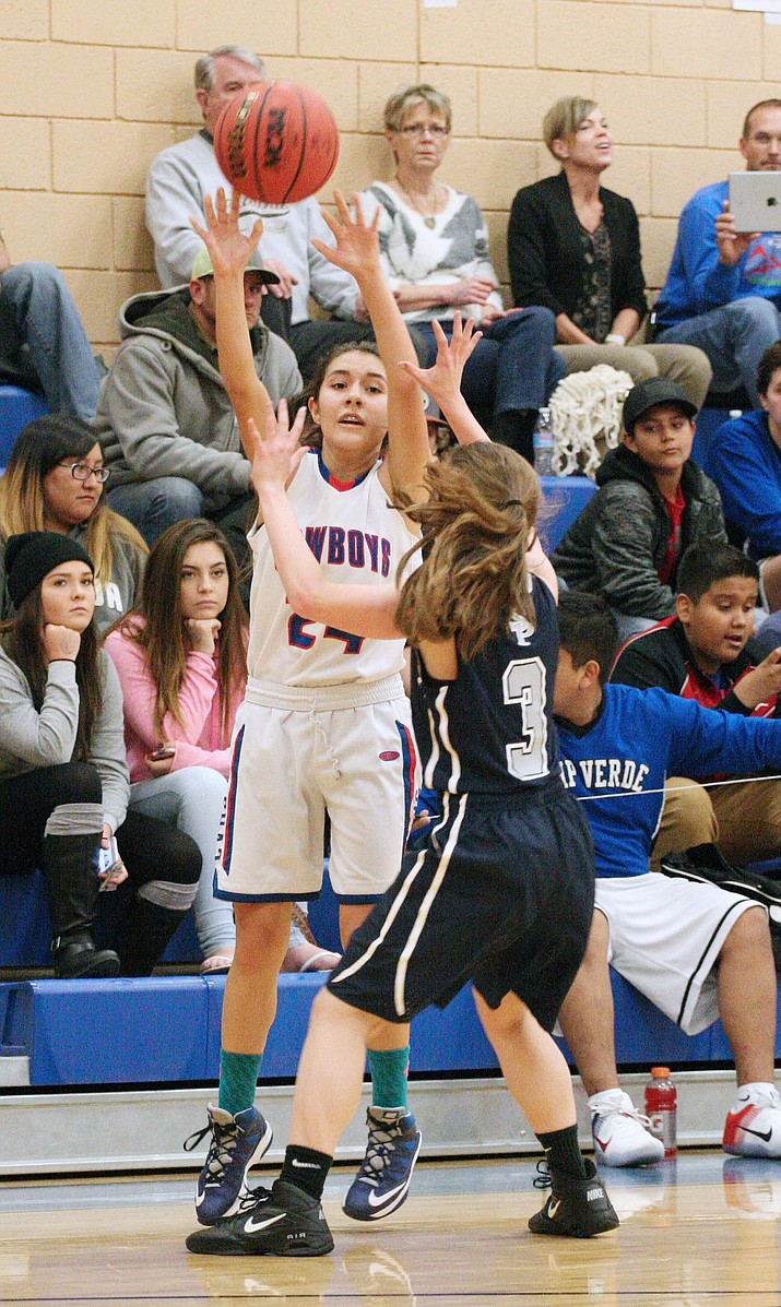Camp Verde guard Hope Ontiveros, top photo, scored eight points Tuesday to help the Lady Cowboys win on the road at Chino Valley, 40-30.