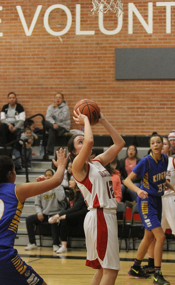 Lee Williams' Kaylee Bond goes up for two of her eight points against Kingman Friday night.