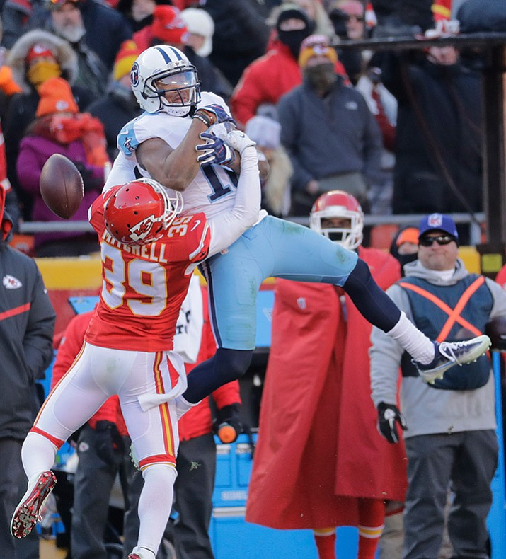 Kansas City Chiefs defensive back Terrance Mitchell (39) breaks up a pass intended for Tennessee Titans wide receiver Rishard Matthews (18) during the second half of an NFL football game in Kansas City, Mo., Sunday, Dec. 18. Tennessee won 19-17.