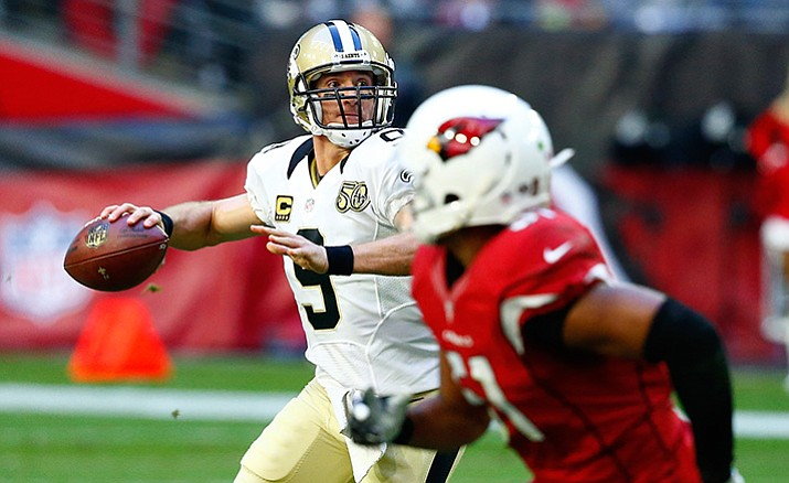 New Orleans Saints quarterback Drew Brees (9) throws against the Arizona Cardinals during the first half of an NFL football game, Sunday, Dec. 18, in Glendale.