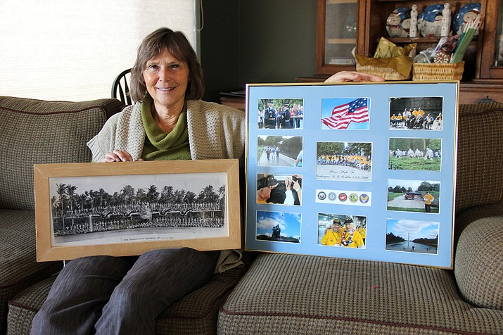 Susan Howe with her father's photo from World War II.