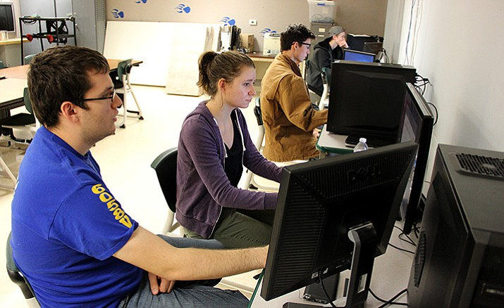 Prescott High School students Gabriel Proctor, left, Malia Harris, Nicholas Kissel and Zachery Griswold voluntarily spend a Saturday participating in a CyberPatriot National Youth Cyber Defense Competition.