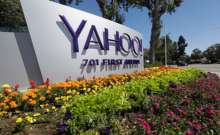 This July 19 photo shows a Yahoo sign at the company's headquarters in Sunnyvale, Calif. On Wednesday, Dec. 14, Yahoo said it believes hackers stole data from more than one billion user accounts in August 2013.