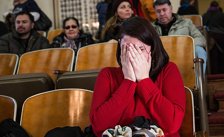 Anne Devlin of Plano, Texas, cries in the gallery of the House of Representatives after the Electoral College voted at the state Capitol in Austin, Texas, Monday, Dec. 19. The ballots of Texas' presidential electors put Donald Trump over the 270 electoral votes needed to formally win the White House.
