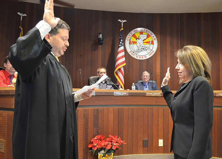 Municipal Judge Jeffrey Singer administers the oath to Mayor Monica Gates earlier this month.