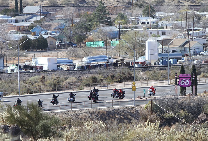 Desert Road Riders members escorted Santa down Andy Devine Avenue from Kingman Ramada to the Boys and Girls Club of Kingman, where he visited with kids and provided toys.