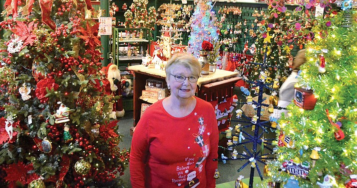 Diana Martin stands inside the Mooey Christmas & Udder Things store in Jerome.
