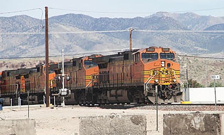 A BNSF train similar to this one struck a van after the vehicle's driver found himself stuck on the tracks Friday night.