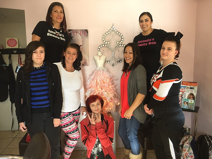 Amanda's Beauty Box provided free haircuts for select students from Williams Elementary-Middle School Dec. 13. Over a two-hour period, stylist and owner Amanda Orozco and beautician Marina Valerio cut the hair of 23 students. Pictured from left: Daeja Lomas, Orozco, Nicole Gay, Kayla Jackson, Valerio, Maya Caldwell and Taya Giacomelli.