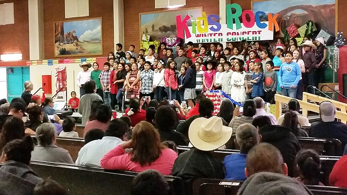Under the direction of Tuba City Primary music teacher Stephen Almquist, students give a public presentation of holiday songs and songs in the Navajo language. Instruments were also played during part of the Kid's Rock winter concert. Photo/Rosanda Suetopka