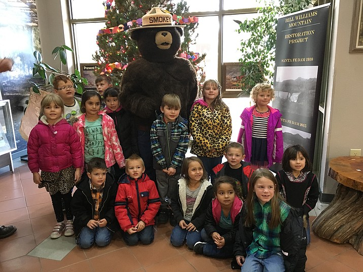 Natlie Mann's class helps Smokey decorate the Kaibab National Forest District Office.