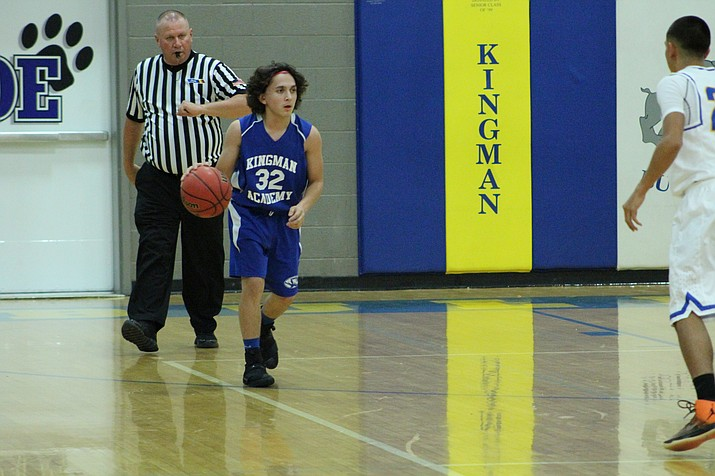 Kingman Academy's Nate Perea brings the ball up against Kingman, Nov. 21.