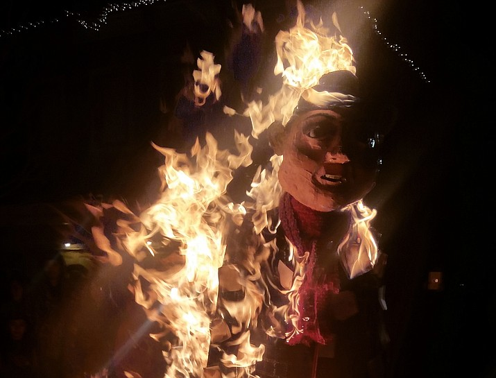 Party goers light an effigy at the 2015 New Year's Eve celebration at Wild West Junction. This tradition of burning the old year is symbolic of cleansing the bad from the previous 12 months before the new year commences.