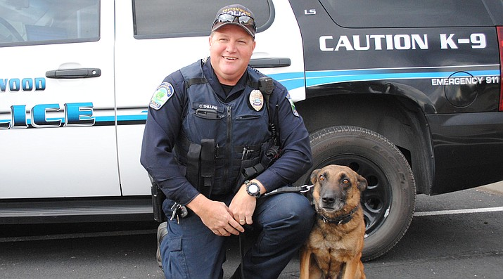 K-9 Jax and Officer Cory Shilling of Cottonwood Police Department pose for a picture outside of their building. Jax will be retiring in January. (VVN/Jennifer Kucich)