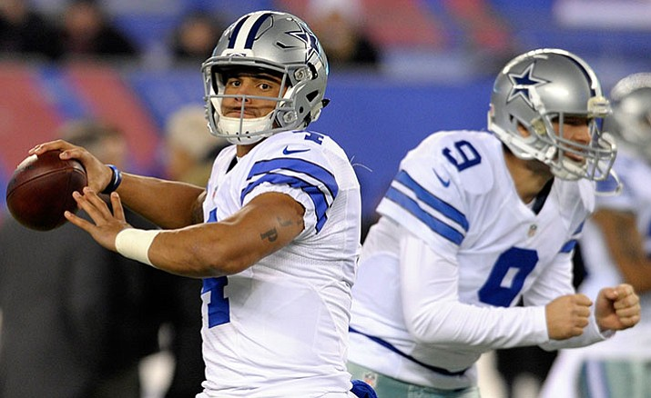 Dallas Cowboys quarterback Dak Prescott (4), with Tony Romo (9) in the background, warms up before a Dec. 11 game against the New York Giants. The Cowboys play the Detroit Lions on Monday, Dec. 26.