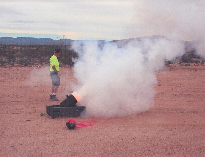 "A real treat was experienced when the members watched the firing of a ""bowling ball"" mortar."
