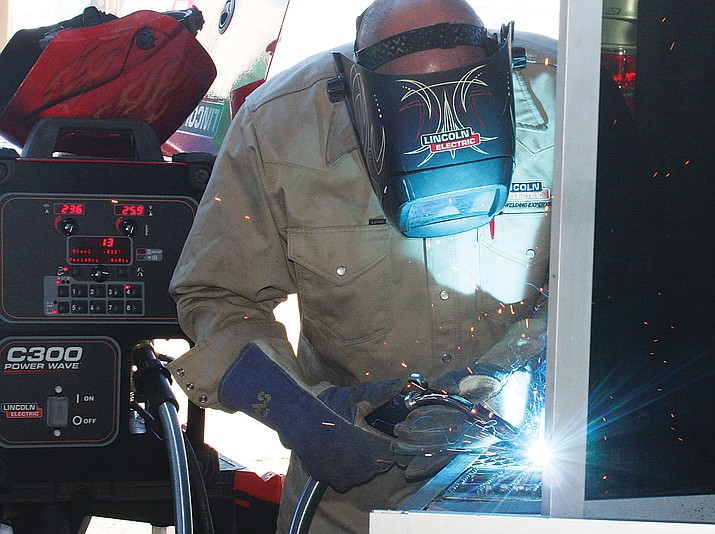 John Weber of Lincoln Electric provides a welding demonstration several years ago at Mohave Community College. Degrees and certificates from community colleges are earning those who hold them quality wages.