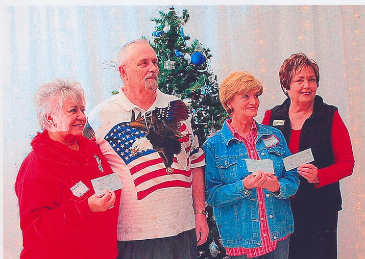 From left to right: Peg Carlson, For the Luv of Paws; Bob Whitsell; Cheryl Edwards, Last Straw Horse Rescue; and Janet Watson, Kingman Cancer Care Unit.