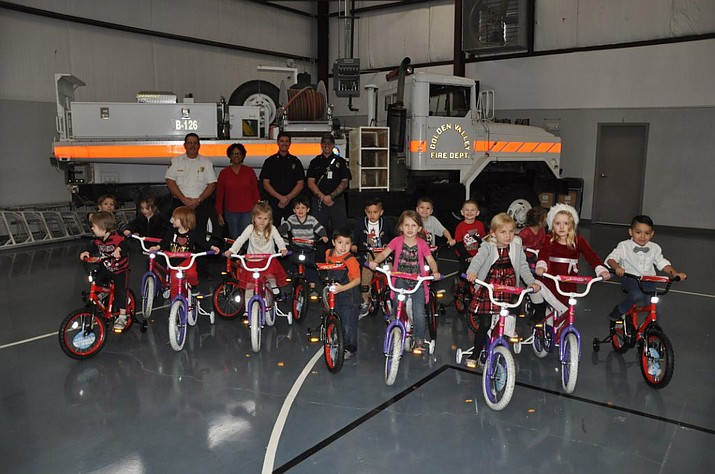 Pictured with the children are (left to right) GVFD Fire Chief Jack Yeager, Head Start Center Manager Leigh Battle , GVFD Firefighter-EMT Jarod Marks, and GVFD Firefighter-Paramedic Jimmy Childers. Head Start Teachers Sherri Shackelford and Julia Sikora also attended the giveaway and helped with the party.