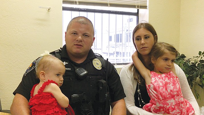 Officer Farmer and his family.