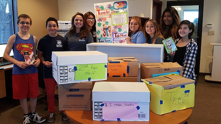 The eighth-grade student council at Acorn Montessori School donated a bookcase they made themselves, full of age-appropriate books, to West Yavapai Guidance Clinic's children's counseling center on Windsong Drive in Prescott Valley.