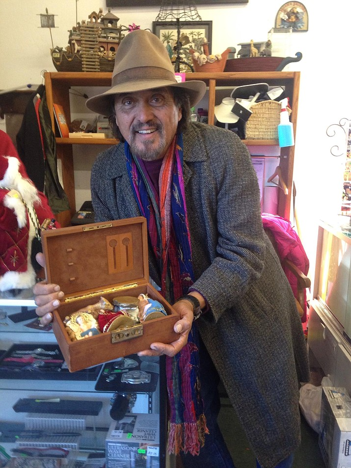 Prescott resident Mike Shepard displays the nativity set he found recently on the shelves of the local NOAH's thrift store. Shepard recognized the nativity figures as the ones he and his siblings had decorated 53 years ago.