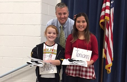 The winner was fourth-grader Toni Ann Harris, on the right, and runner up was fellow fourth-grader Shaelyn Braithwaite. Principal Clark Tenney is with them.
