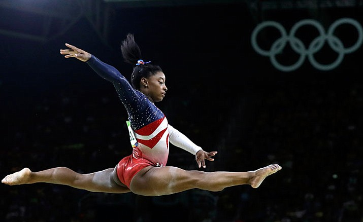 United States' Simone Biles performs on the balance beam during the artistic gymnastics women's team final Aug. 9 at the Summer Olympics in Rio de Janeiro, Brazil. Briles was selected as the AP Female Athlete of the Year, on Monday, Dec. 26.